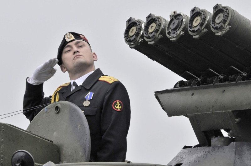 A Russian seaman trains for a military parade to mark Navy Day in Russia's far eastern city of Vladivostok