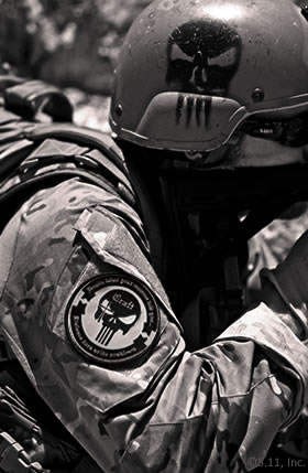 Craft International tactical gear – note the skull symbol painted on the helmet and emblazoned on the uniform patch