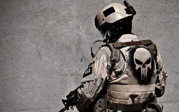 Military tactical gear with The Punisher's skull symbol painted on the back